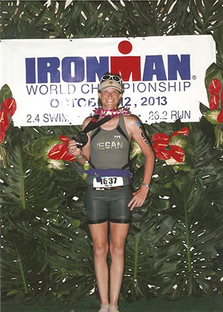 Photo of Jen Clark finishing Ironman 2013