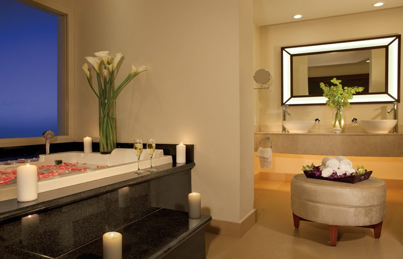 The spacious Preferred Club Master Suite bathroom offers dual vanities and a large tub with stunning views.
