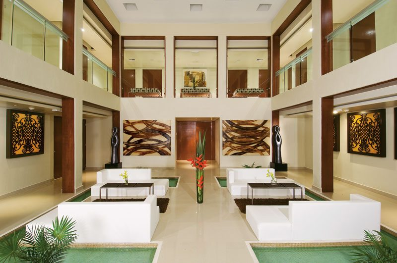 The chic spa lobby area at Secrets Silversands with ample seating arrangements.