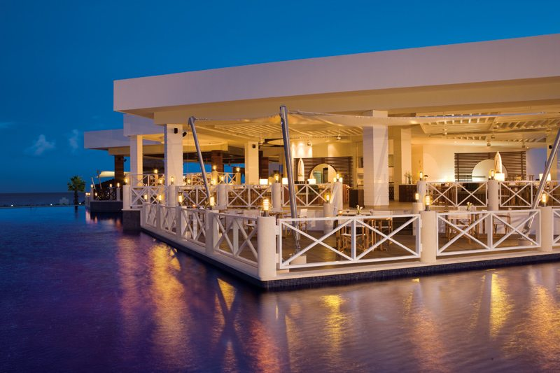 Exquisite and romantic table settings at the Oceana Restaurant serving gourmet seafood under the stars.
