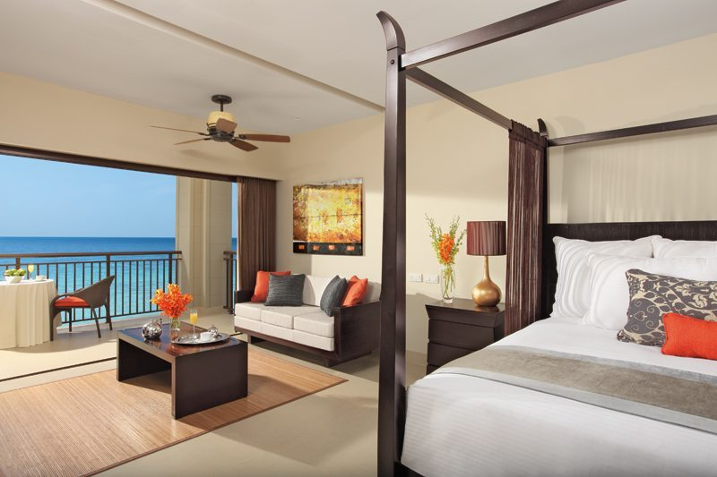 The Junior Suite Ocean View offers a four poster king bed, separate living area and a balcony with breathtaking views of the Caribbean