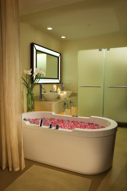 The Junior Suite bathroom offers a large soaking tub, dual vanities and a separate shower.