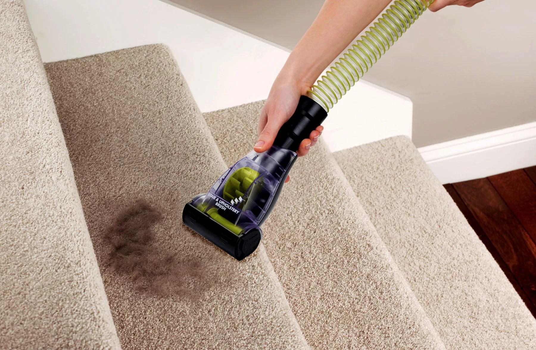 The vacuum should have appropriate tools for surfaces such as carpeted stairs