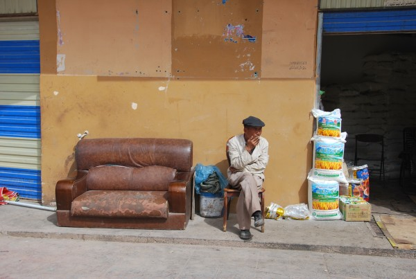 A Chinese man sits on the streets of Kashgar
