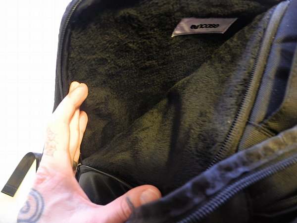 The laptop compartment is made of soft, fleece-like fabric.