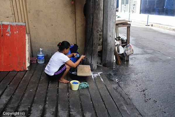 Manila woman washing clothes