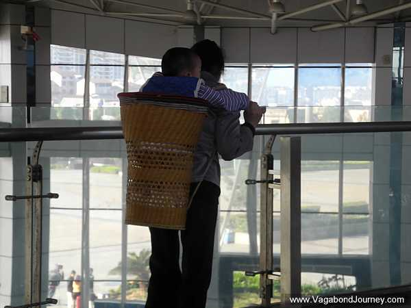 baby being carried in a basket
