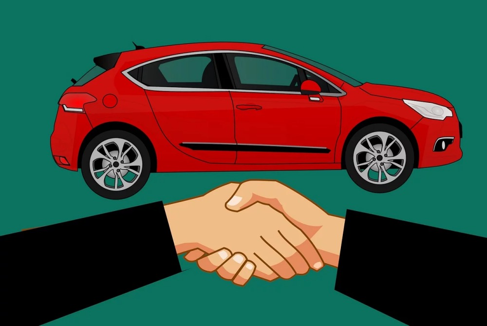 Shaking hands car