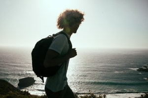 Backpacker walking beach