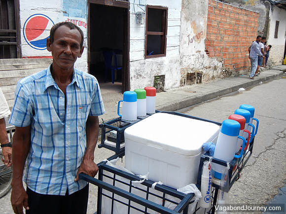 Man working in the informal economy selling coffee and beverages