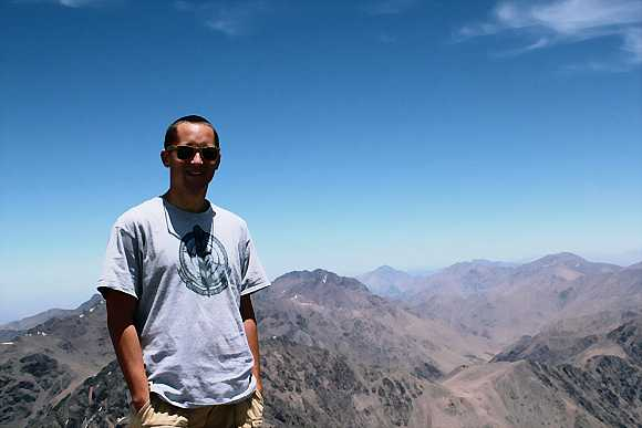 Pierre Laurent on the summit of Toubkal Mountain in Morocco
