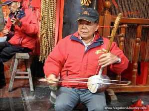 Taiwanese musician playing a huqin