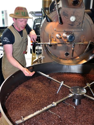 Master Roaster Joe Stoddart tends the roaster at Havana Coffee. Photo by Katherine Rodeghier
