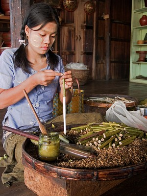 Along Inle Lake, young women work long hours rolling tobacco leaf