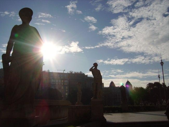 Sky Sun and Statue Silhouette in Barcelona
