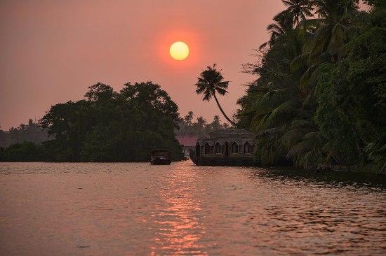 sunset along the Malabar coast in the backwaters of Kerala, Indi