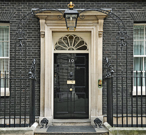 Number 10 Downing Street and its iconic door By Prime Minister's Office (http://www.number10.gov.uk/tour/) [see page for license], via Wikimedia Commons