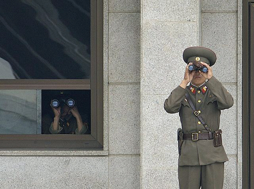 Joint Security Area - North Koreans keeping watch By Edward N. Johnson [Public domain], via Wikimedia Commons