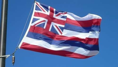 Flag of the state of Hawaii flying at Haleakalā National Park on Maui, Hawaiʻi By The uploader (Own work; taken by the uploader) [Public domain], via Wikimedia Commons