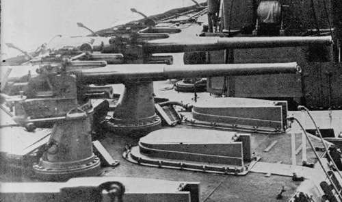 Photograph showing 2 QF 12 pounder 18 cwt guns mounted on the roof of X turret, HMS Dreadnought (1906).