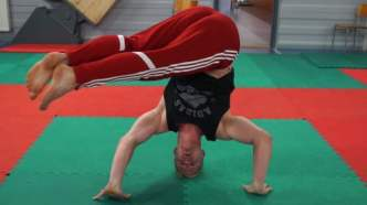 Twisting headstand