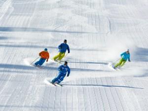 Adult ski school class skiing