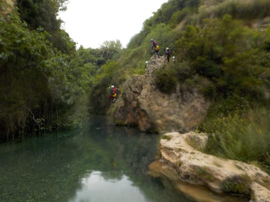 Jumping into the river pools.