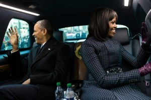 Barack_and_Michelle_Obama_wave_from_the_presidential_limousine