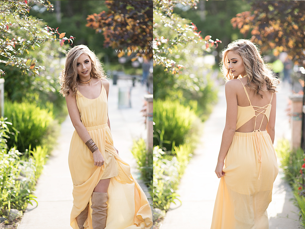 senior girl walking in a yellow dress in kalamazoo on westnedge