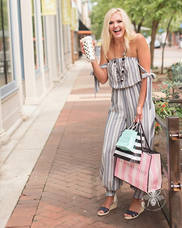 senior girl poses with coffee and shopping bags