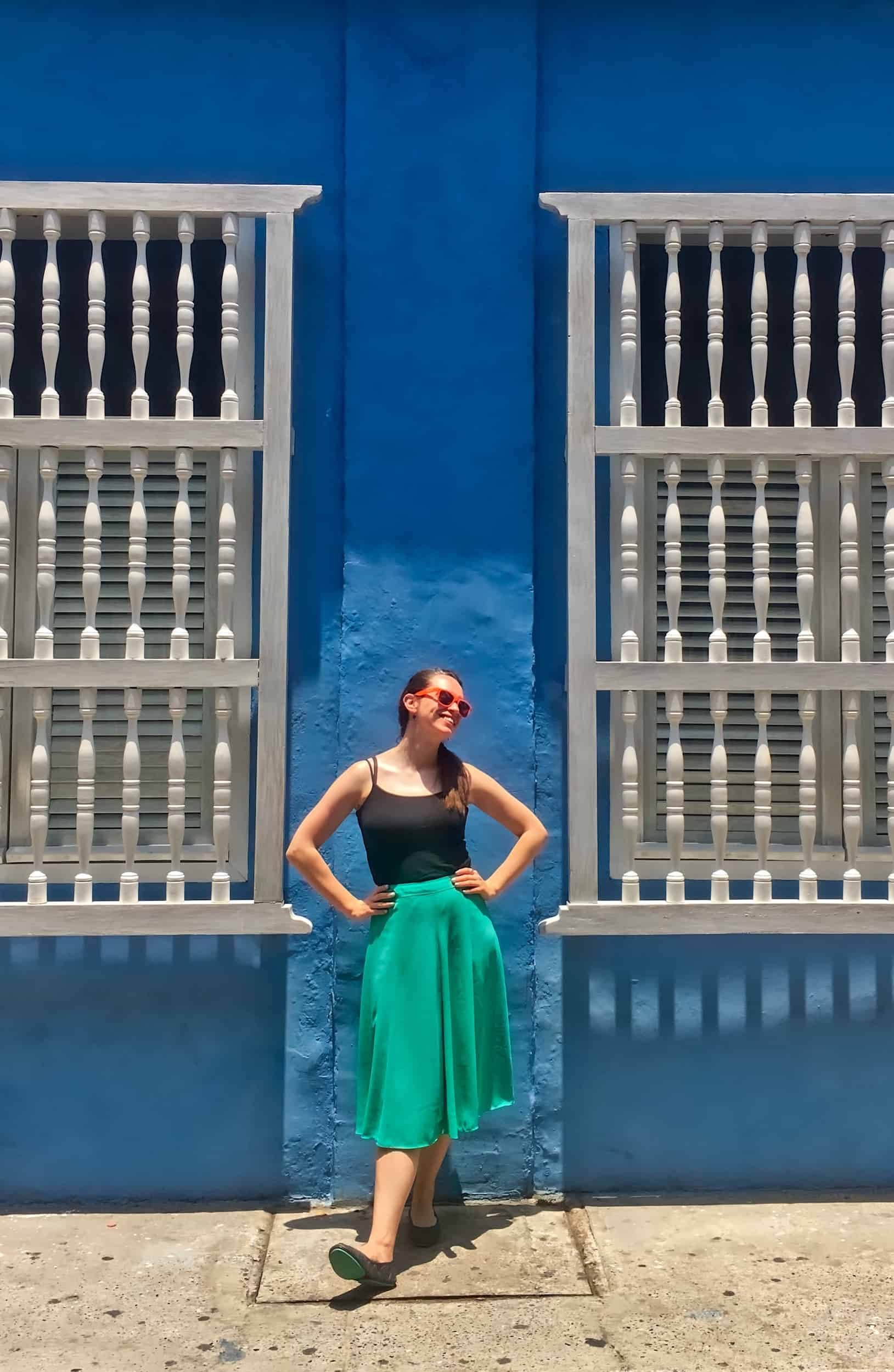 Cartagena Walking Tour - Valerie in front of blue wall