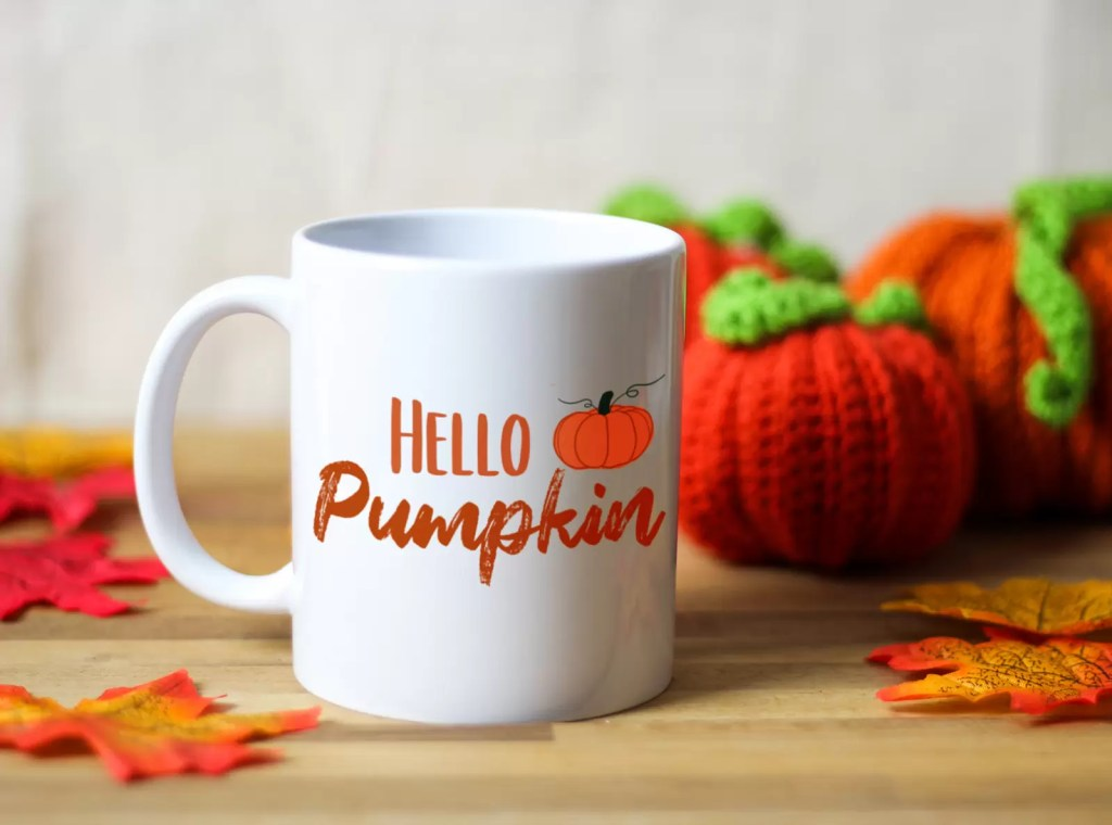 White ceramic mug with the words hello pumpkin and an illustration of a pumkin