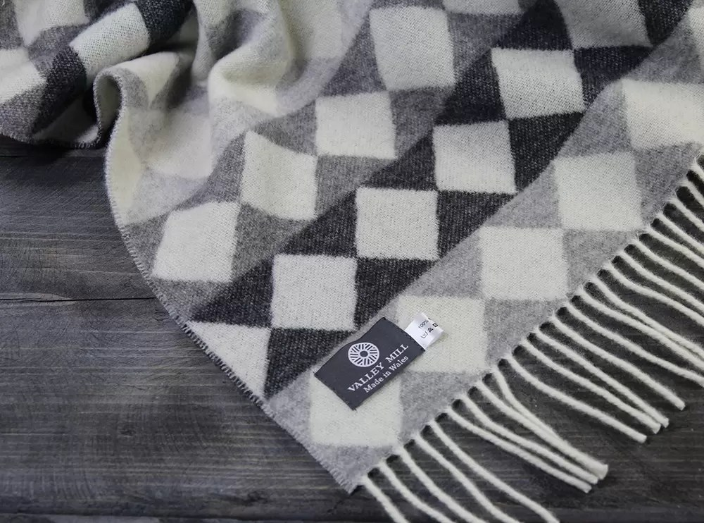 Merino wool monchrome check Valley Mill blanket. Whites and shades of grey.