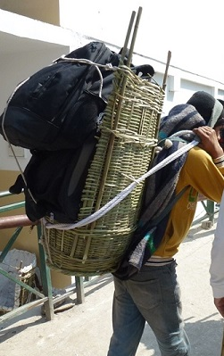 Porters carrying bags, He can carry 3-4 medium size bags, as shown in picture.