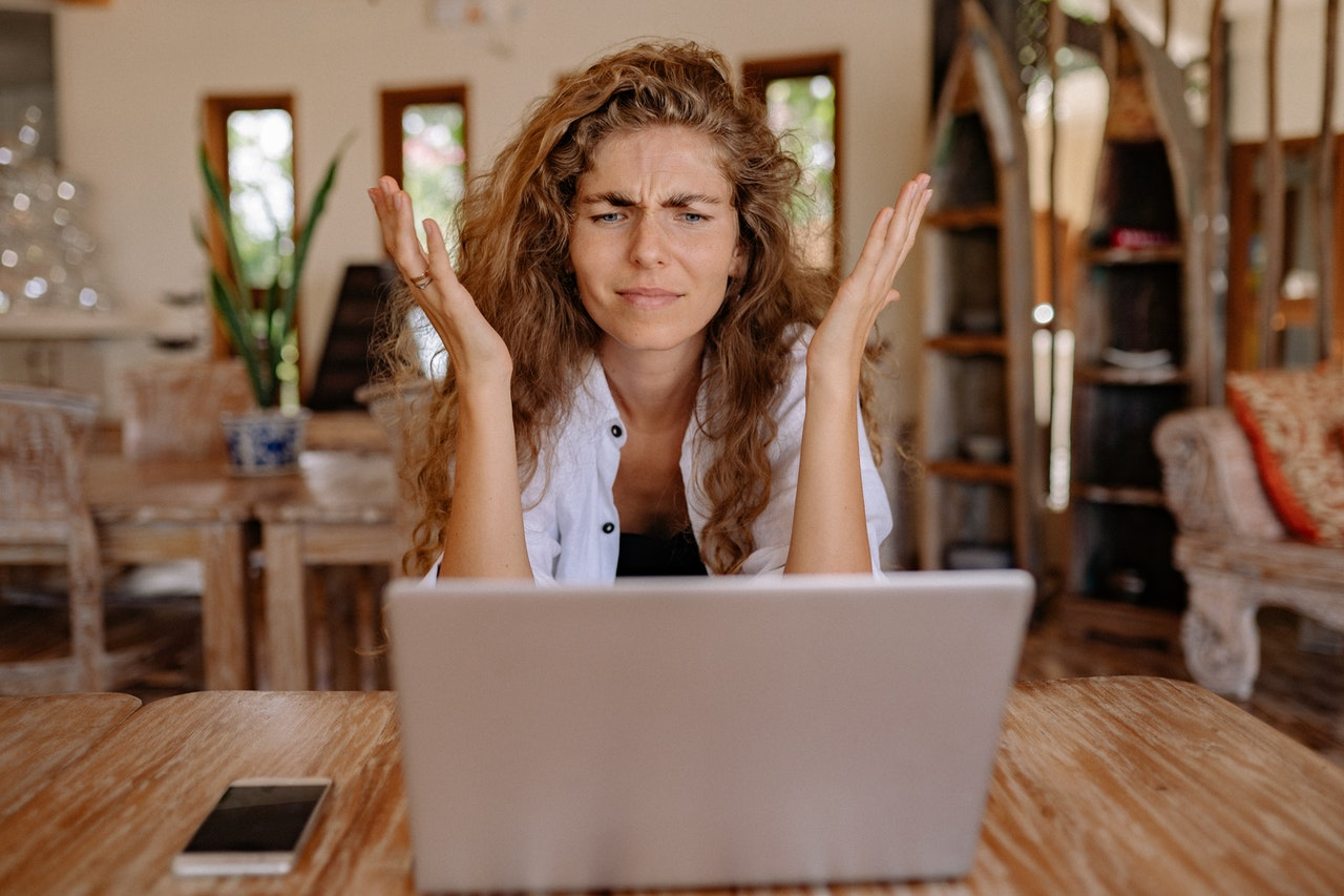 Get a designer... Frustrated woman at laptop