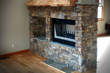 Thin Sandstone Fireplace with custom wooden mantle