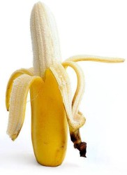 partly peeled banana and banana skin
