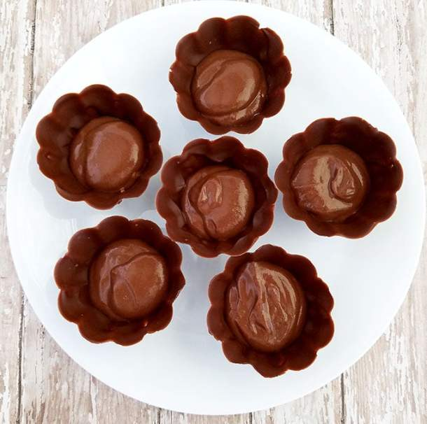 Assembling Instructions: Place ¼ cup of chocolate pudding onto the bottom of the chocolate cup.