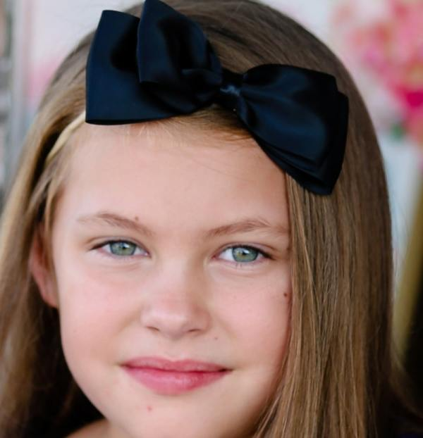 black headband with bow on top
