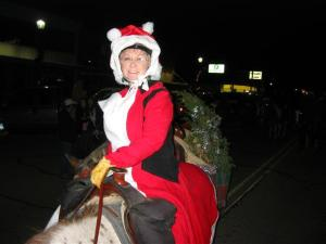 Carolyn Barcus on horseback as Mrs. Claus