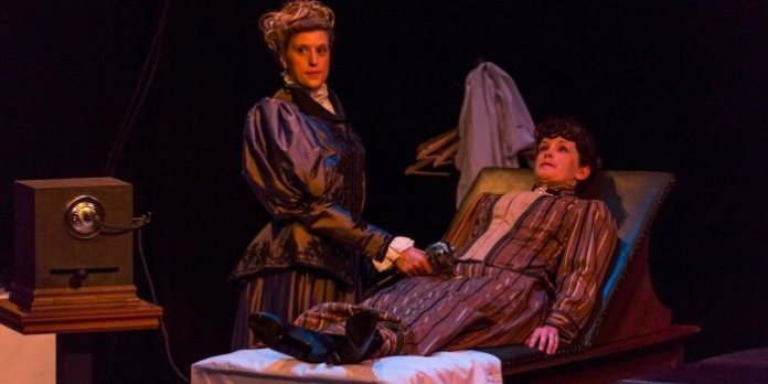 Christine Reinfort and Lindsay Nelson in the Ensemble Theatre Company production of In the Next Room, or the Vibrator Play. Photo by Javier Sotres.