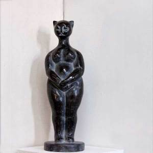 Figurative sculpture of cat-person, black marble, by Ellen Scobie