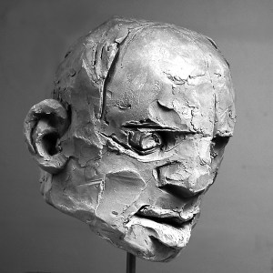 photograph of clay figurative sculpture of old man's head
