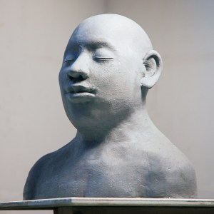 figurative sculpture in clay of male bust