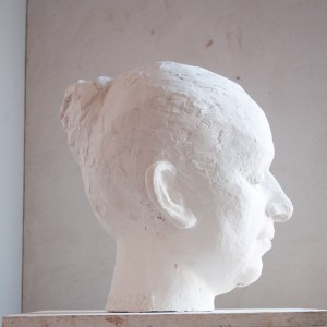 figurative fine art sculpture of female nude in plaster using traditional sculpture techniques