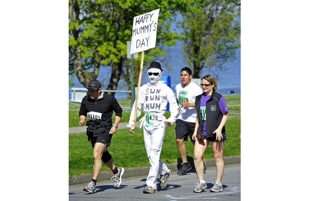 A costume clad participant in the 26th Annual Vancouver Sun Run makes his way through the streets of Vancouver, Sunday, May, 09, 2010.