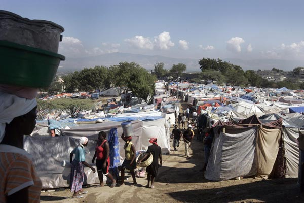 People go on with their lives at Petionville Club IDP camp, where  more than 50,000 people have moved into makeshift tents when they lost  their homes in the January 12 earthquake in Port-au-Prince Feb. 7,  2010.
