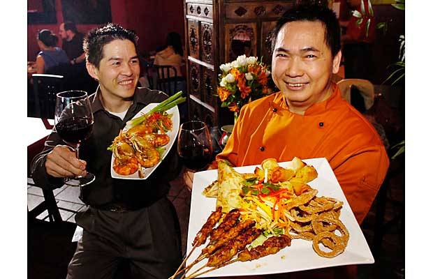 Chef Robert Phua (right) and owner Louis Leung inside the Tamerind Hill restaurant in New Westminster.