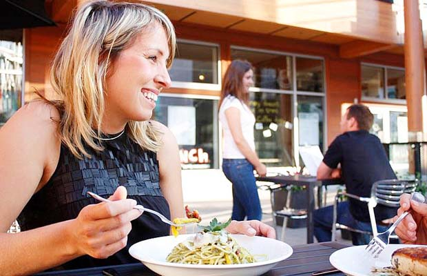 Rachel Dempster, owner of Munch Bistro, with vegetarian pesto linguine on restaurant patio in North Vancouver.