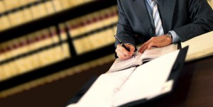 Man writing at desk Injury Attorneys in Vancouver WA